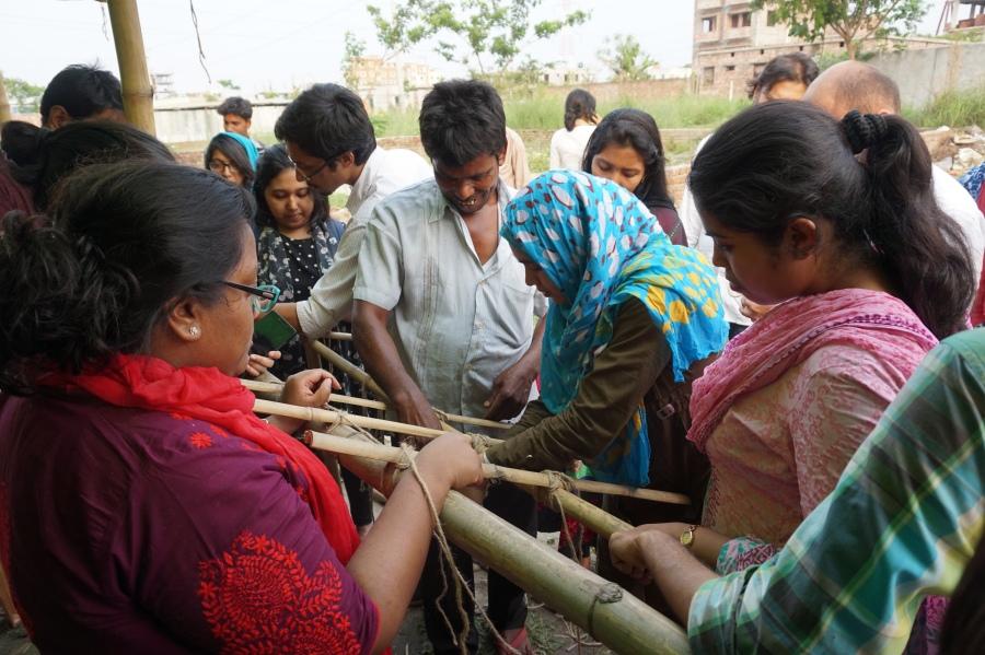 7 _ learning local bamboo construction techniques from lead construction facilitator Badshah Bhai.JPG
